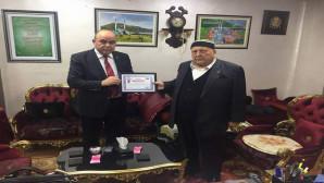 YOGİSAD Başkanı Çelik'ten Bilal Şahin'e teşekkür plaketi