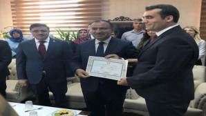 Başbakan Yardımcısı Bozdağ, mazbatasını aldı